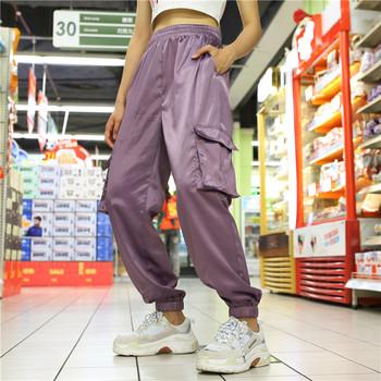 Дамски анцуг с висока еластична талия и странични джобове в светъл цвят