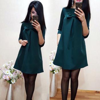 Модерна дамска рокля широк модел  с елемент панделка на бюста
